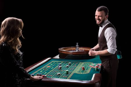 Croupier and woman player at a table in a casino. Picture of a c
