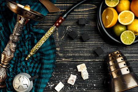 Stylish Smoking hookah and basket with lemon, lime and orange on