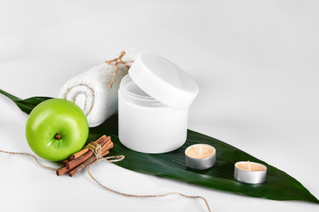 Natural spa beauty treatment cleansing products with apple on white background. The concept for advertising cosmetics. Still life. Copy space Stock Photo