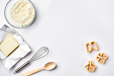 Preparation of the dough. Ingredients for the dough - flour, butter and various tools. On white background. Free space for text . Top view. Still life. Flat lay Stock Photo