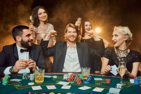 Poker players sitting around a table at a casino. 写真素材