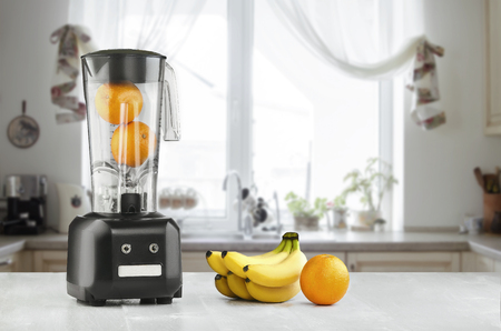 Blender, fruits and kitchen space Stock Photo