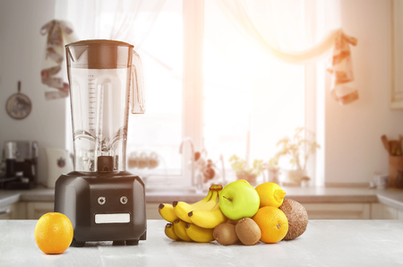 Blender, fruits and kitchen space. Sun flare Stock Photo