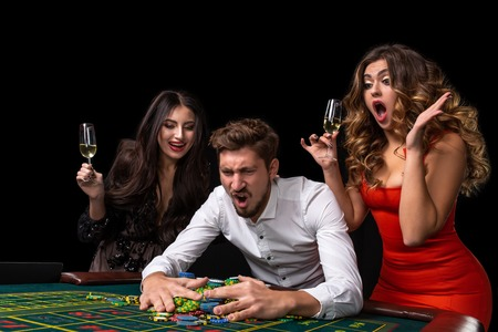 Adult group celebrating friend winning at roulette