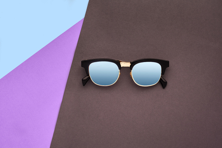 Minimal style. Minimalist Fashion photography. Fashion summer is coming concept. Sunglasses on a colorful background