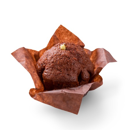 Delicious chocolate muffin on white background. Fresh chocolate cakes in decorative paper.