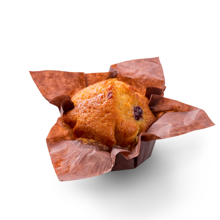 Delicious muffin on white background. Fresh cakes in decorative paper. Stock Photo