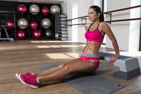 Fit woman exercising workout out arms exercise training triceps and biceps doing push ups.