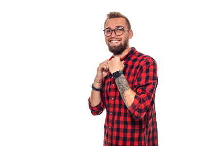 Handsome man model studio portrait. Boy casual style, trendy hipster in checkered shirt look with cool hairstyle Stock Photo