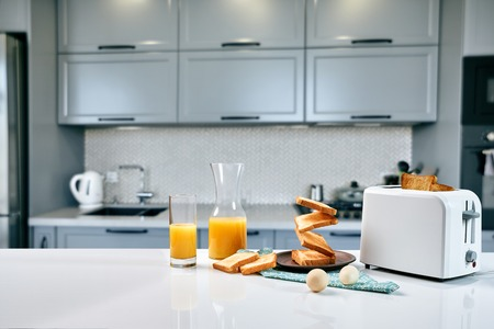 Flying toasts for breakfast and a glass of orange juice drink. Levitation food and healthy breakfast concept. Stock Photo