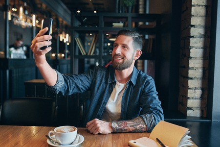 Man looking into the camera while making a selfie