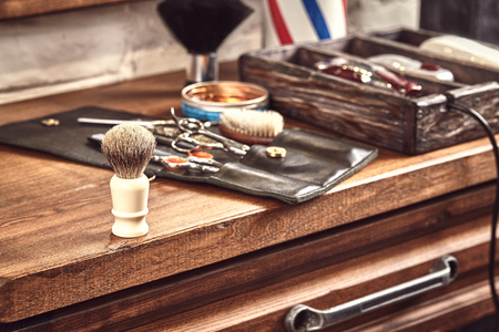 Hairdresser tools on wooden Foto de archivo