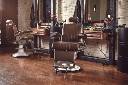 Barbershop armchair. Modern hairdresser and hair salon, barber shop for men.