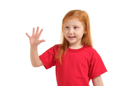 A little girl shows gesture - five fingers, isolated on white background 免版税图像