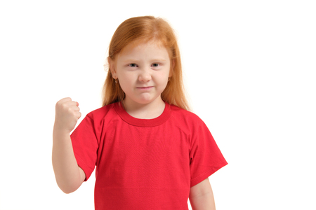 Close-up portrait mad young girl about to have nervous atomic breakdown, fist up in air, angry with someone isolated white background. Stock Photo