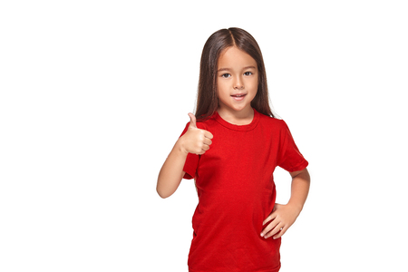 Girl in red t-shirt shows her hand with thumb Stock Photo