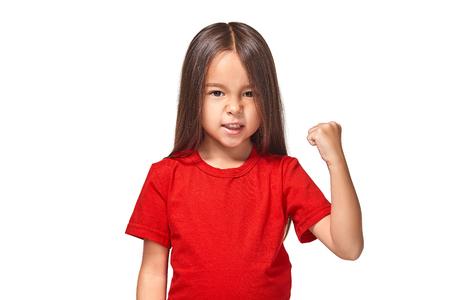 Beautiful girl in red t-shirt shakes her fist 版權商用圖片