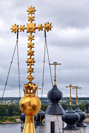 Eastern orthodox crosses on gold domes, cupolas, against blue sky with clouds Stok Fotoğraf