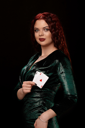 Young beautiful woman with playing cards over black. Casino