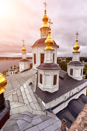 Eastern orthodox crosses on gold domes, cupolas, against blue sky with clouds Imagens