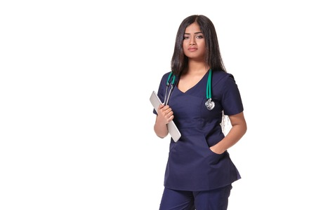 Portrait of young indian doctor woman with stethoscope around neck isolated on white background Imagens