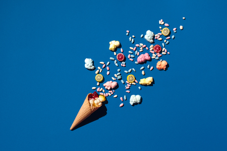 An image of a heap of jelly bean that is sprinkled from a waffle cone