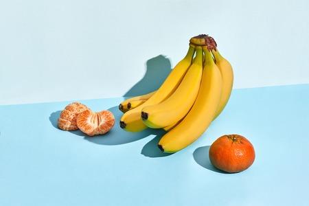 Composition of fresh fruits, banana and mandarin, half of peeled mandarin
