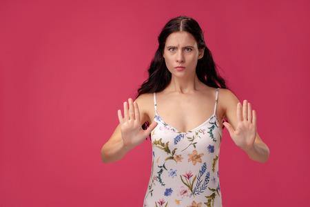 Attractive young woman saying no no