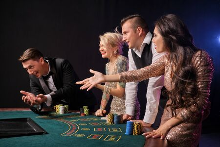 Group of a stylish rich friends are playing poker at casino. Stock fotó - 125458313