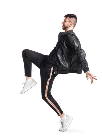 Full-length photo of a funny guy dancing in studio isolated on white background. Stock Photo