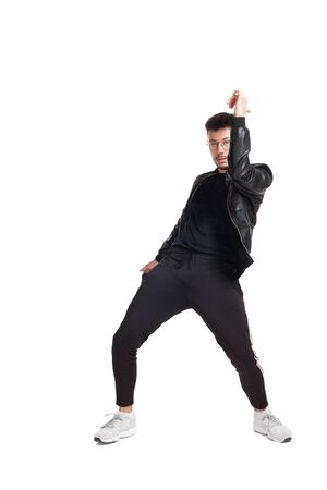 Full-length photo of a funny guy dancing in studio isolated on white background. 免版税图像
