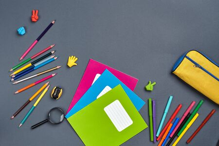 Flat lay photo of workspace desk with school accessories or office supplies. Imagens