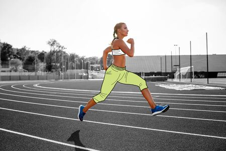 Woman athlete in a cartoon sport clothes is running by the track of a professional stadium. 版權商用圖片