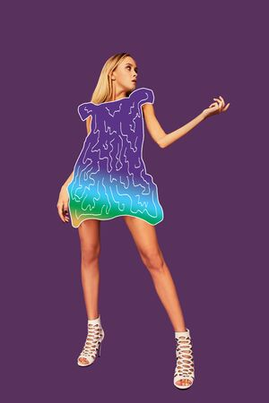 Full-length studio shot of a gorgeous blonde female in a cartoon mini dress posing against a colorful background. Stock fotó