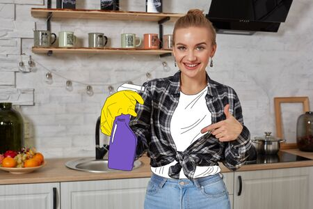 Young blonde woman in a checkered shirt is posing at the kitchen.