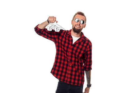 Young man in a casual cartoon shirt and glasses is holding a drawn skateboard on his shoulder.
