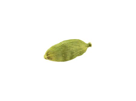 Green cardamom pod isolated on white background with copy space for text or images. Used as flavorings in both food and drink, as cooking spices and as a medicine. Frame composition, close-up shot. Zdjęcie Seryjne