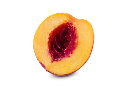 Unpitted, smooth-skinned, sappy half of nectarine fruit isolated on white background with copy space for text or images. Variety of peach. Side view. Close-up shot.