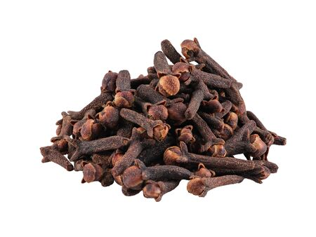 Small pile of clove isolated on white background with copy space for text or images. Spices and herbs. Food, cooking, restaurant, packaging concept. Frame composition, close-up, side view. Stock Photo