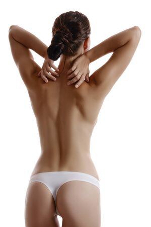 Woman in panties touching her spine, posing standing back to the camera, isolated on white. Plastic surgery, aesthetic cosmetology concept. Close-up. Imagens
