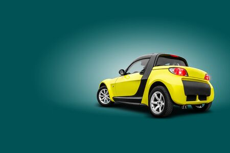 Brand new yellow car is standing back to the camera on blue background. A realistic shadow is drawn in under it. Collage. Copy space for your text or images, close-up. Side view.