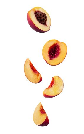 Set of smooth-skinned nectarines with kernels and without them isolated on white background with copy space for text or images. Side view. Close-up.
