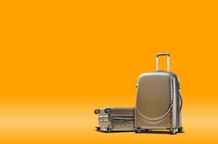 Two gray suitcases are standing against an orange background. A realistic shadow is drawn in under them. Collage. Copy space, close-up.