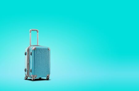 Blue suitcase is standing against turquoise background. A realistic shadow is drawn in under it. Collage. Copy space, close-up.
