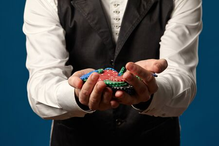 Newbie Holding some colored chips. Imagens