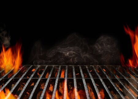 Hot empty portable barbecue BBQ grill with flaming fire and ember charcoal on black background. Waiting for the placement of your food. Close up