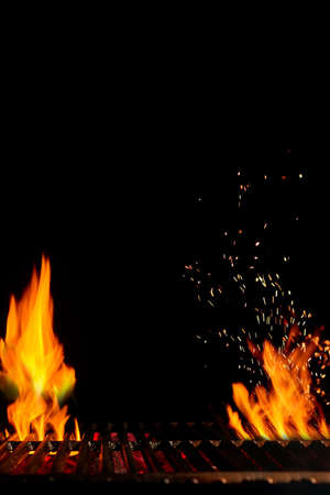 Empty hot barbecue BBQ grill with bright burning fire and sparks, smoldering coal on black background. Close up, copy space 版權商用圖片 - 151849957