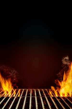 Hot empty steel barbecue BBQ grill with bright flaming fire and smoke on black background. Ready for the placement of your food. Close up, copy space 版權商用圖片 - 151849972