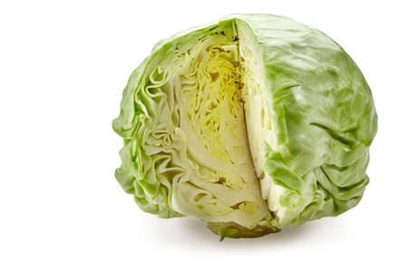 White-headed, light green cabbage without one cut off section. Isolated on white background. Smooth-leafed vegetable. Close up, copy space
