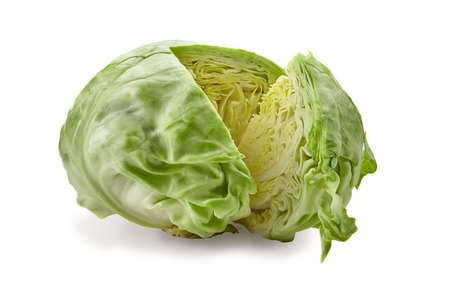Fresh harvested, pale green cabbage and one cut off section. Isolated on white background. Smooth-leafed vegetable. Close up, copy space
